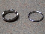 Aleph 2 Scalloped Titanium (L) and Stock Chrome Aluminum (R) Bezel Rings